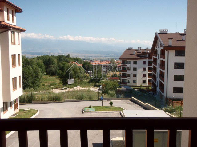 2 bedroom apartment with a fireplace in mountain dream spa wellness bansko ibg real estate for Mountain view 2 bedroom apartments